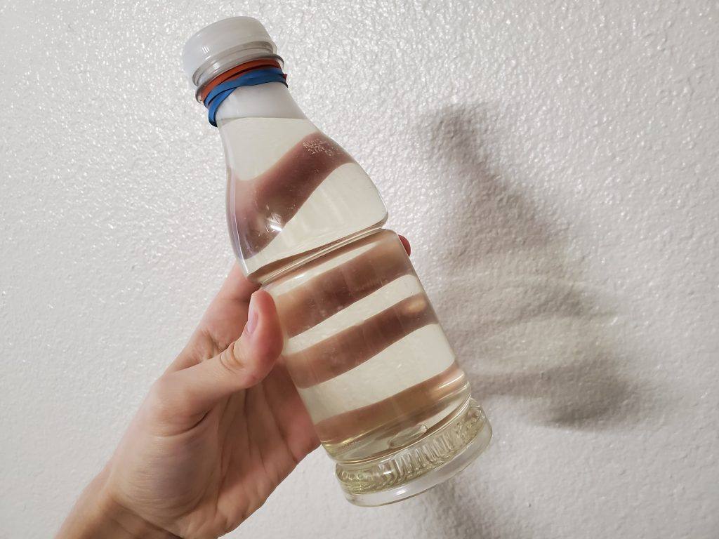 Picture of dissolved Long Live The Hemp hemp extract in clear water bottle